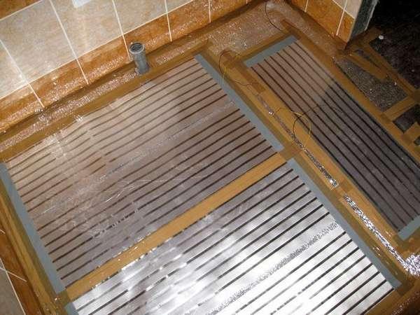 Пленочные инфракрасные обогреватели можно постелить и под ламинат