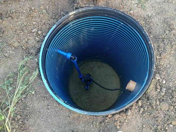 Прекрасно оборудованный колодец для питьевой воды