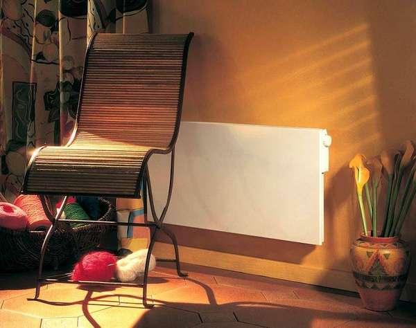 Установка обогревателя конвекторного типа с терморегулятором на стену