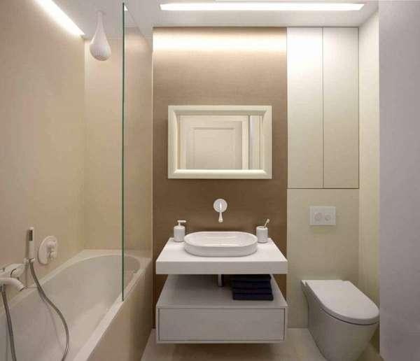 Над унитазом можно расположить встроенный шкафчик, тем самым решив вопрос хранения гигиенических или моющих средств